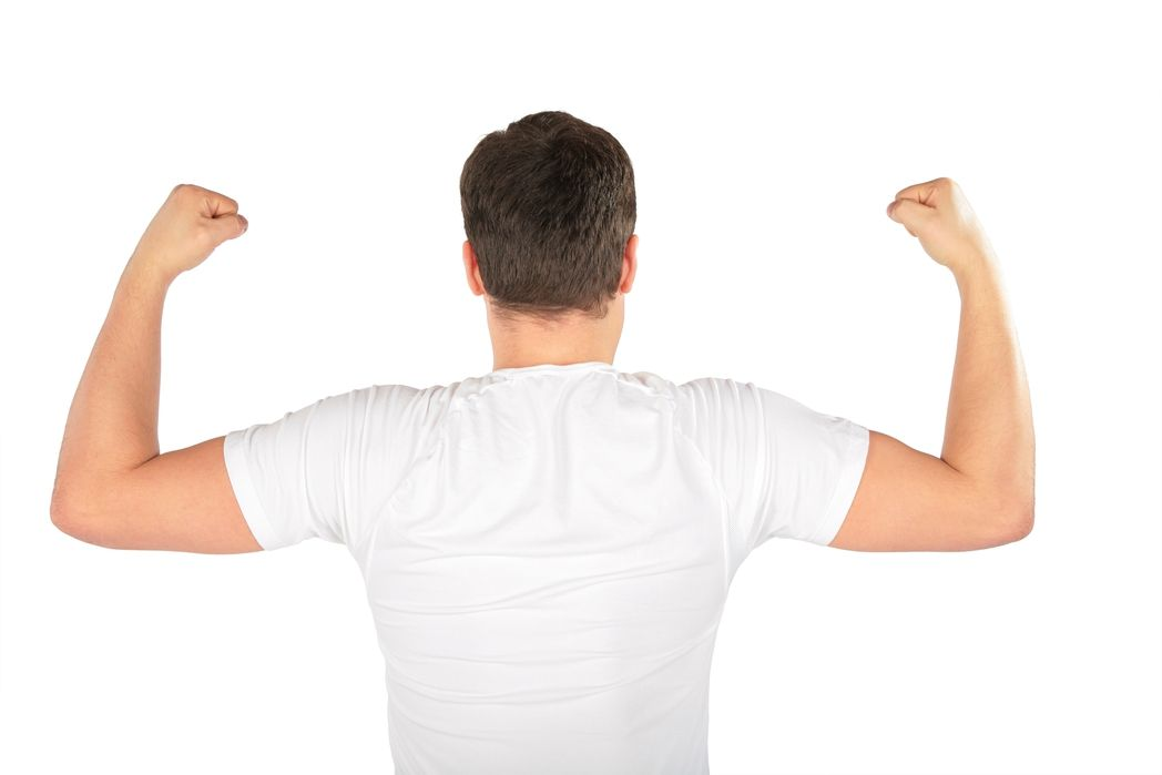 The back of a man wearing a white shirt