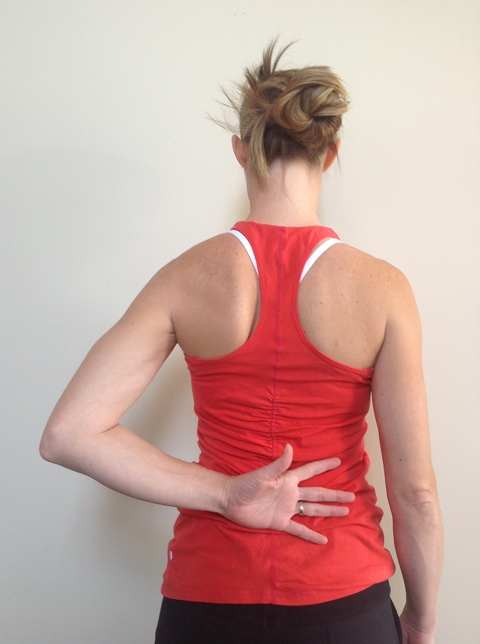 woman dealing with back pain