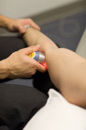 woman getting laser therapy on her leg