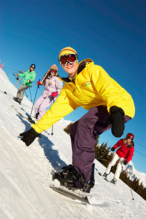 group of skiiers and snowboarders