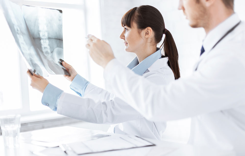 doctor and nurse checking xray of back