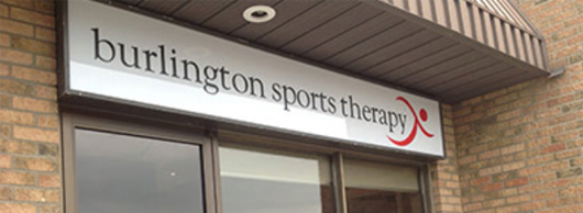 White Burlington Sports Therapy Sign with black text