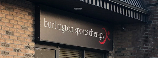 Black Burlington Sports Therapy Sign with white text